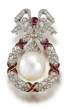 A belle époque freshwater natural pearl, ruby, and diamond brooch, circa 1905.  The circular-cut ruby and single-cut diamond fluttering ribbon bow surmount suspending a large freshwater baroque pearl drop with rose-cut diamond cap, within a millegrain-set single-cut diamond wreath surround, accented by calibré-cut ruby ribbons.