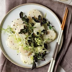 Dashi-Poached Scallop Salad with Wasabi Dressing | Dressed with lemon juice and wasabi and topped with greens, the poached scallops become a satisfying first course.