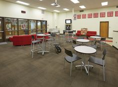 Cafe tables in varying heights invite students into the library at Eisenhower High School, IL | DEMCO Interiors