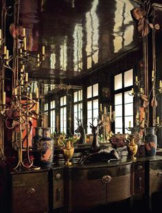 """For twenty-five years, Yves Saint Laurent and Pierre Bergé built the decor of their lives, in a magnificent apartment in Paris on la rue de Babylone. Before the masterpieces are scattered at the """"sale of the century"""" at Christie's, St Laurent, Perfume Paris, Tinted Mirror, Ethnic Decor, Round Mirrors, Large Mirrors, Paris Apartments, Celebrity Houses, Arquitetura"""