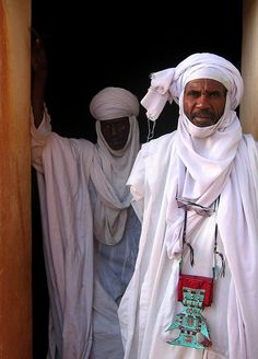 Tuareg men at the Mosque of Agadez, Niger by Norbert Righetto via flickr