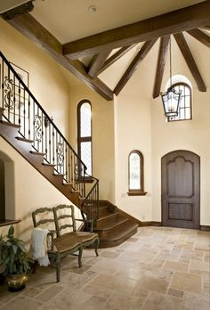 Custom ironwork and reclaimed beams...love, love love this! The colors, the architecture, the stairway railings.  Beautiful!