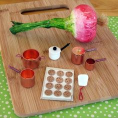 Fairy Pots and Pans made from things like copper end caps and white plastic leg tips.  Disney Family also has craft ideas for other fairy-sized things like a table and chairs, fairy cottage, etc.  Definitely making these for Ashlyn.  She'll love them!