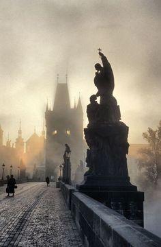 The Charles Bridge is a famous historic bridge that crosses the Vltava river in Prague, Czech Republic.