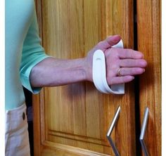 Arthritis Handle - Aids for Daily Living: Specifically designed for use by individuals who have trouble grasping, this handle enables the user to open any cupboard doors and drawers with ease, no gripping or twisting required.