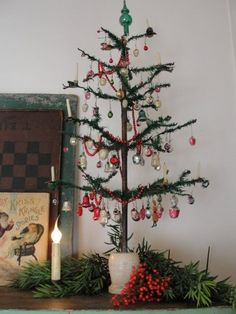 Cutest feather tree with Christmas tree candles. www.christmasgiftsfromgermany.com.