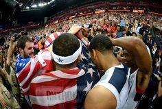 The United States players celebrate winning the Men's Basketball gold medal game between the United States and Spain on Day 16