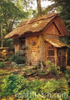 Cordwood garden shed w/ thatched roof and rabbit hutch