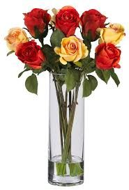 More than any other flower, the Rose beckons the eye (and nose), literally demanding a closer inspection. Delicate blooms adorn fresh green stems (replete with thorns! A beautiful vase with faux water completes the look. Artificial Flower Arrangements, Silk Flower Arrangements, Flower Vases, Artificial Flowers, Red And Yellow Roses, Silk Flowers, Golden Yellow, Faux Flowers, Wooden Roses