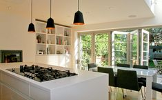 rogue-designs interior designer oxford, interior architecture oxford, custom interior design oxford: Extension with Leicht Kitchen and Nigel Slater Inspired Folding Doors