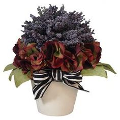 """Add a welcoming touch to your buffet spread with this faux hydrangea and heather arrangement, or let it add organic appeal to your nightstand.     Product: Faux floral arrangementConstruction Material: Silk, plastic, nylon and clayColor: Purple, burgundy, green, black and whiteFeatures: Includes faux heather and hydrangeasDimensions: 12"""" H x 13"""" DiameterNote: For indoor use only"""