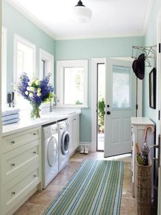 I love all the windows, the colors, the big counter to fold clothes on...my dream laundry room!!