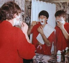 Paul and John took a break from writing songs to shave.