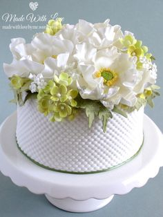 White Poppy and Hydrangea Cake by Pamela McCaffrey …See the cake: http://cakesdecor.com/cakes/149954-white-poppy-and-hydrangea-cake