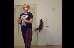 """This Cat Will Stop At Nothing To Prevent Her Human From Singing """"Let It Go"""". lol cat was like how about no"""
