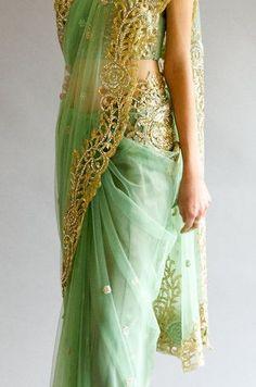 Sage green colour cut work saree with swarovski crystals