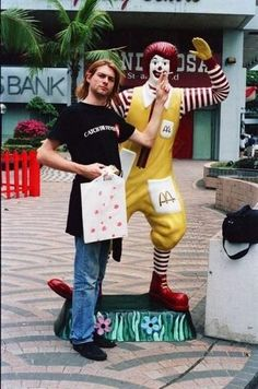 Kurt putting a cigarette into Robald McDonald's mouth!