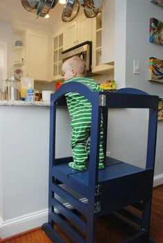 learning tower.. Domi needs this he loves to try to see what momy is doing on the table hed love it Birthday present maybe??