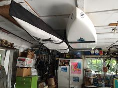 double paddleboard storage rack-can also store kayaks, surfboards, skis, snowboards, etc. #ceilingstorage #garagestorage #supstorage #kayakstorage #surfboardstorage #storeyourboard