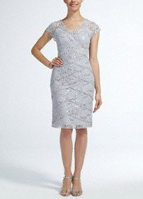 Sparkle and shine in this fabulous lace and sequin Mother of the Bride dress!  Cap sleeve bodice features ultra feminine lace and dazzling sequin detail.  Tiered skirt adds dimension and creates a flattering silhouette.  Fully lined. Side zip. Imported nylon/poly blend. Hand wash.  Please Note: Sale pricing varies according to color, please click color and size to view pricing.Also available in plus sizes as Style S356930.