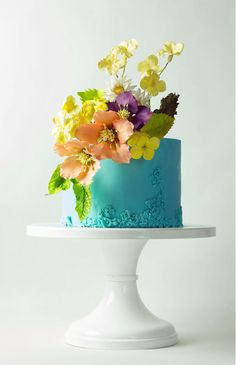 Lina Veber wedding cake. Blue + yellow + mauve + orange wedding cake. Perfect spring wedding cake. See more wedding cakes: http://www.melaniemorel.com/wedding-cakes-work-art/