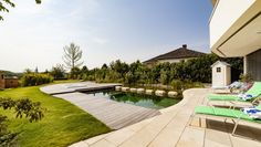 This yard helps to showcase how different materials can be mixed when adding onto a space without feeling disconnected or out of place. Swimming Pool Photos, Swimming Pool Designs, Swimming Pools, Wood Pathway, Pallet Walkway, Deck Design, Landscape Design, Garden Design, House Design