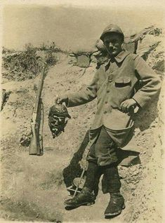 1915: A Trophy Of War  Pictured: Original Caption-Champagne 1915, cadavre allemand.  A French soldier holding the decapitated head of a German soldier complete with picklehaube. The poor man would surely have been a victim of an artillery shell.  There are several articles on the page that discuss the impact of such photographs which were openly published in newspapers and magazines both in France and Germany. The British newspapers etc, were more sensitive or should I say subjected to…