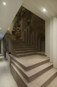 love this stair. exposed rock through. Veronica Beach House / Longhi Architects