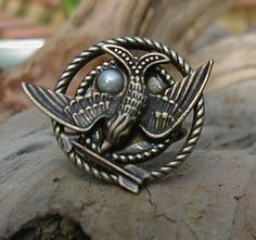 This one is for me. heart the mockingjay pin with peeta's pearl. #hungergames