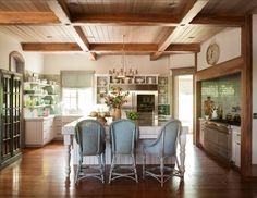 FARMHOUSE – INTERIOR – vintage early american farmhouse showcases raised panel walls, barn wood floor, exposed beamed ceiling, and a simple style for moulding and trim, like in this farmhouse in décor de provence, country french magazine.
