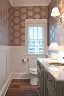 Love the board and batten, patterned upper wall, wood floors, marble vanity top