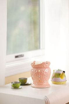 Tiara Mid-Size Scentsy Warmer PREMIUM  A pink confection straight out of a little princess's fantasy: faux jewels and a swirling pattern, topped with a fairy crown. Price: $30.00 Check out Scentsy's new Layers on my website https://deannawallace.scentsy.us/Home. They are all amazing contact me to order today! If you are interested in receiving a catalog, a free scent sample, ordering, hosting a party, or joining my team please contact me!!!