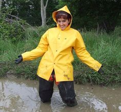 Water waders and yellow rainwear.
