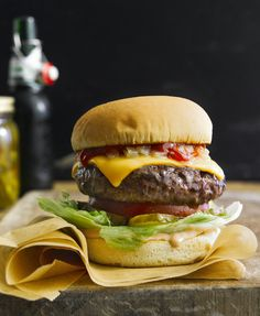 Photography by John Cullen. •FOOD STYLING TIP: For melting cheese on a burger, simmer a little water in a saute pan and dip the cheese in it for a couple of seconds before you place it on the burger. Magic!!