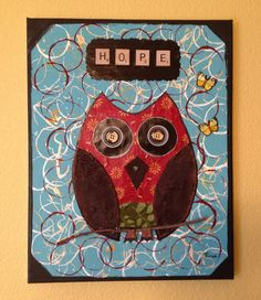 This is a mixed media collage/wall art piece on an 11 x 14 inch canvas.The canvas background was created using newspaper, acrylic paint and various abstract stamping techniques. The owl was created using fabric, buttons, beads and up-cycled water bottle caps for the eyes. The owl has a gloss fin...