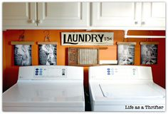 Adorable display between washer/dryer and cabinets using wooden hangers and black & white pictures