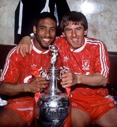 Liverpool legends John Barnes and Peter Beardsley hold the 1990 Division 1 League trophy and #LFC's 18th in total. #LFC #thekop