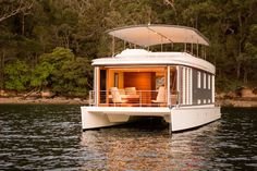 The beautiful upper deck pales in comparison to the living room in an eco-friendly houseboat