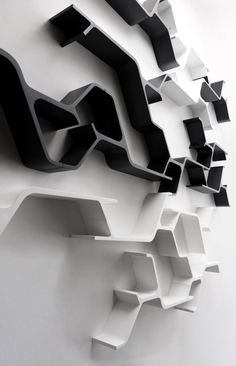 Wall shelf modular design offers an infinite variety of compositions - Synapse is a shelf designed by Sebastian Errazuriz modular design of the Chilean system in 2010.