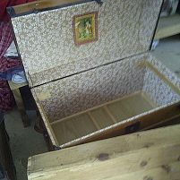 new interior of trunk with original lithograph print in the lid