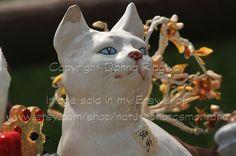 White ceramic cat stock photo digital by NaturePhotosMontana, $3.50