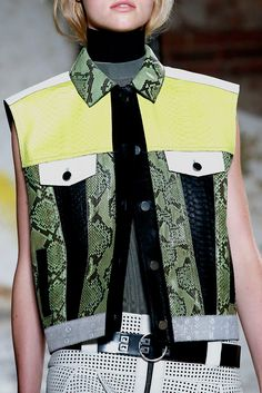 Proenza Schouler S/S 2013, Close up of leather patch work detailing onto a work wear style jacket