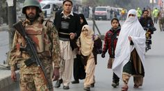Parents escort their children away from a school attacked by the Taliban in Peshawar on Tuesday, December 16. Militants stormed the military-run school in northwest Pakistan, killing at least 130 people, most of them children. The Pakistan Taliban claimed responsibility for the attack, one of the bloodiest in the South Asian nation's history.