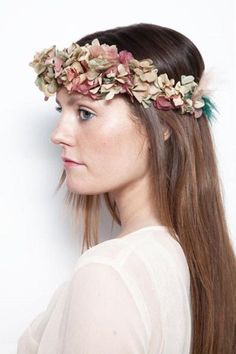 Warm colored flowers make a lovely autumnal flower crown - we love the funky touch of blue fur as the tie