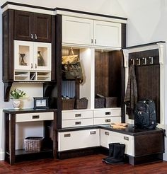 Don't let the stress after a long day follow you inside. We love the idea of being able to leave it at the door with this mudroom featuring Wellborn Cabinet, Inc.!