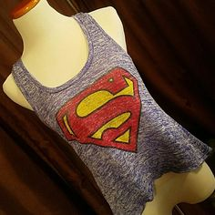 """SUPERMAN Brand: Superman, DC Comics Item: Sweater knit racer back tank with Superman logo on front. Color: Blue & White Heather, Red, Yellow Size: Large Measurements: Armpit to armpit is 17"""". Shoulder to hem is 20"""" Materials: 53% Rayon, 43% Poly, 2% Spandex Condition: Excellent, pre-loved condition. Superman Tops Tank Tops"""