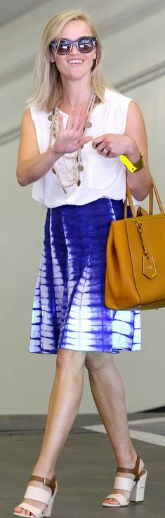 Wtho made  Reese Witherspoon's tan tote handbag, blue tie dye skirt, and sandals on July 23, 2013?