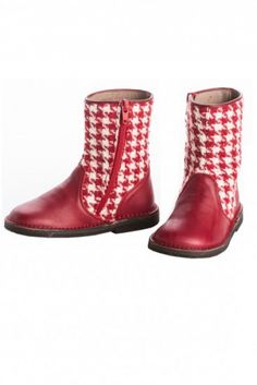 Red leather hand-stitched boots are accented with houndstooth fabric for added flair. A durable sold makes this a choice that will last all season long, and a zipper makes it easy for her to take her shoes on and off. Girls Boutique, Boutique Clothing, Leather Boots, Red Leather, Houndstooth Fabric, Girls Designer Clothes, Online Clothing Boutiques, White Boots, Baby Feet