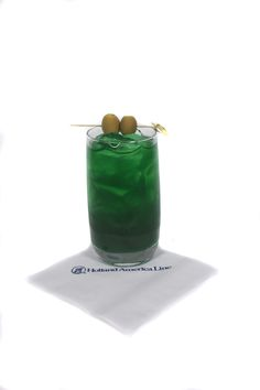 St. Patrick's Day Cocktail - Irish Ball -  3 oz. Crème de Menthe Green 3 oz. Amaretto 2 oz. Sour Mix  Build in a hi ball glass over ice. Garnish with 2 olives on a pick.