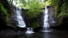 Wildman Falls - Mount Magazine State Park  by William Rainey on Capture Arkansas // This beautiful double falls flows out of the wild and rugged mountains of Mount Magazine and it is the only place in 12 years that I have ever had to have my truck pulled out with a wrecker after being struck at by a snake. If your up for the challenge this one will not dissapoint but don't expect an easy hike and plan to be out before dark.